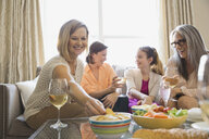 Three generation female enjoying party at home - HEROF01420