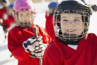 Portrait of cute boy in ice hockey helmet - HEROF01582