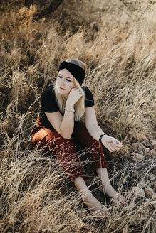 Africa, Namibia, blonde woman in grassland - LHPF00229