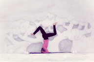 A woman practising yoga in a white room - INGF10962