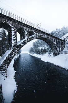 A bridge over a frozen river during winter - INGF11007