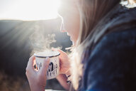 Close-up shot of a woman drinking coffee - INGF11091