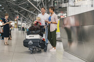 Family of three looking forward to their holiday at CGN airport, Cologne, NRW, Germany - MFF04717