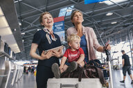 Member of ground crew chatting with traveling mother and child the way at CGN airport, Cologne, NRW, Germany - MFF04753