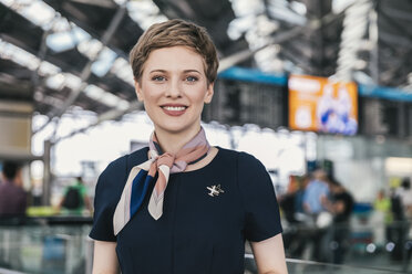 Portrait of smiling airline employee at the airport - MFF04762