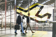 Business people walking at CGN airport, Cologne, NRW, Germany - MFF04765