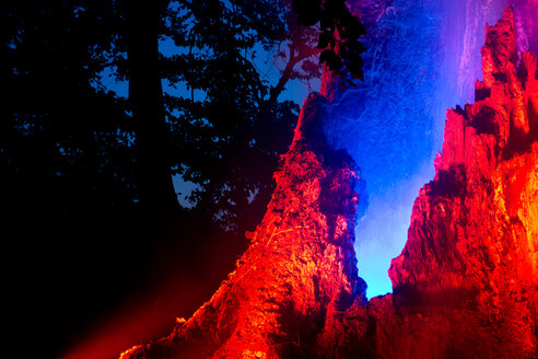Red rocks illuminated in the forest - INGF11247