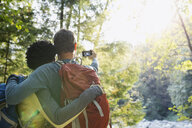 Couple taking selfie in sunny woods - HEROF02025