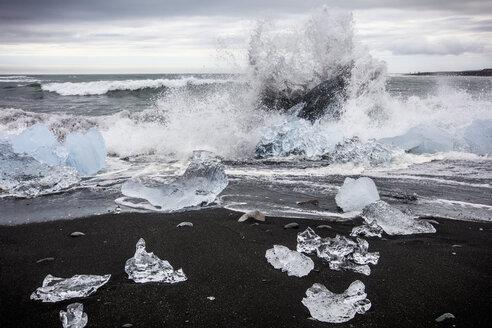 Waves splashing at Diamond Beach, Jokulsarlon glacier lagoon, Iceland - AURF08010