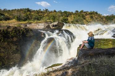 Africa, Uganda, Woman looks at the stunning Murchison Falls, on the Nile, Murchison Falls National Park - RUNF00486