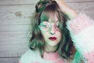 Portrait of beautiful woman wearing nose ring and glasses - SVCF00001