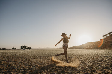 Namibia, Namib desert, Namib-Naukluft National Park, Sossusvlei, woman moving at sunset at Elim Dune - LHPF00231