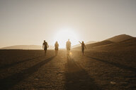 Namibia, Namib desert, Namib-Naukluft National Park, Sossusvlei, friends walking at Dune 45 at sunrise - LHPF00243