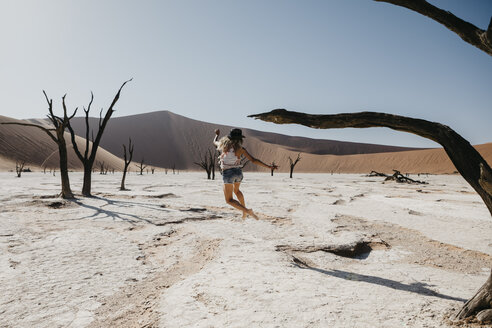 Namibia, Namib desert, Namib-Naukluft National Park, Sossusvlei, woman moving in Deadvlei - LHPF00249