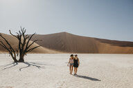 Namibia, Namib desert, Namib-Naukluft National Park, Sossusvlei, two girlfriends walking in Deadvlei - LHPF00252