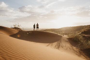 Namibia, Namib desert, Namib-Naukluft National Park, Sossusvlei, two men standing on Elim Dune at sunset - LHPF00255