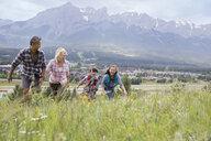 Family hiking on rural hillside - HEROF02090