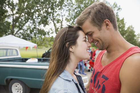 Couple touching foreheads outdoors - HEROF02132