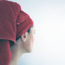 Rear view of a woman wearing a red towel on her head - INGF11431
