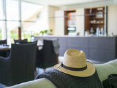 Panama hat on couch in a modern villa - LAF02208