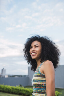 Portrait of smiling young woman outdoors - KKAF03104