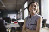Smiling businesswoman in office - HEROF02451