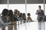 Businessman leading meeting in conference room - HEROF02478