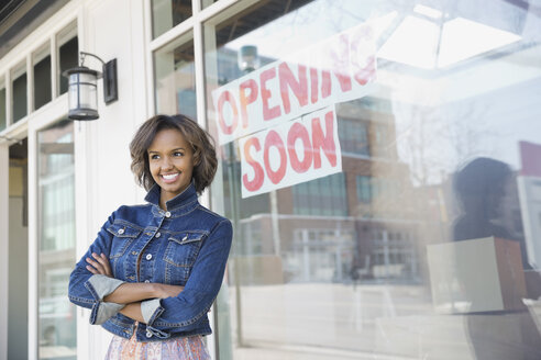 Business owner standing at new storefront - HEROF02607