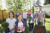 Portrait of smiling multi-generation family gardening - HEROF02721