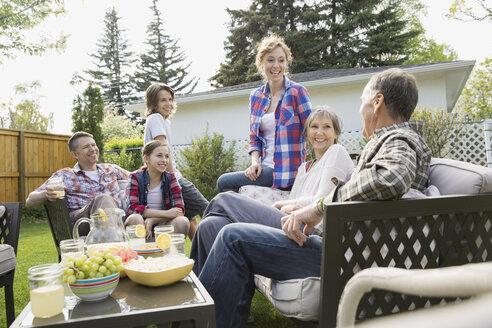 Multi-generation family relaxing in backyard - HEROF02739