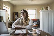Portrait of confident woman at laptop - HEROF02781