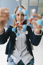Female scientist studying molecule model - GUSF01680