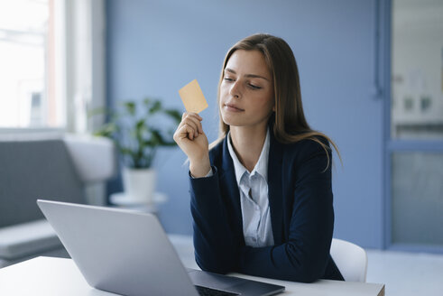 Young businesswoman doing online payment with her credit card - GUSF01767