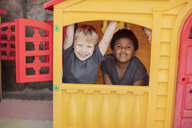 Portrait of happy children in a playhouse - ZEF16070