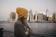 USA, New York, New York City, Female tourist at East River - LHPF00314
