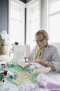Seamstress working at sewing machine - HEROF03132
