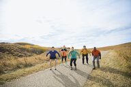 Fitness group jumping on rural path - HEROF03348