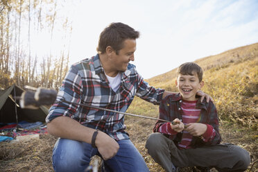 Father and son roasting marshmallows - HEROF03366