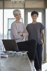 Portrait of two smiling businesswomen in office - RBF06869