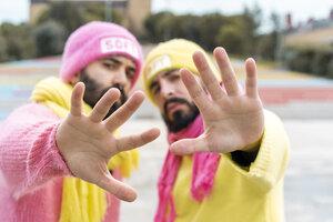 Gay couple raising hands - AFVF02170