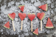 Watermelon heart ice lollies on crashed ice - GWF05741