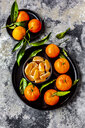 Tangerines with leaves, on plate and pieces in bowl - SARF04040
