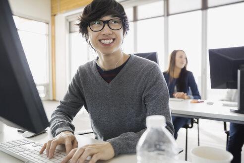 Smiling high school student in computer lab - HEROF03436