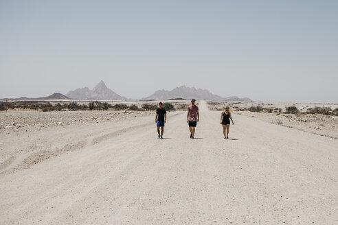 Namibia, friends walking on the road to Spitzkoppe - LHPF00340