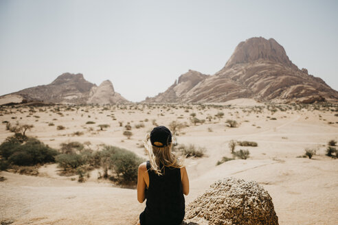 Namibia, Spitzkoppe, rear view of woman looking at view - LHPF00346