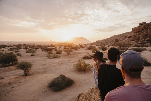 Namibia, Spitzkoppe, friends sitting on a rock watching the sunset - LHPF00373