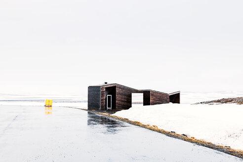 Modern design wooden house in snowy field - INGF11609