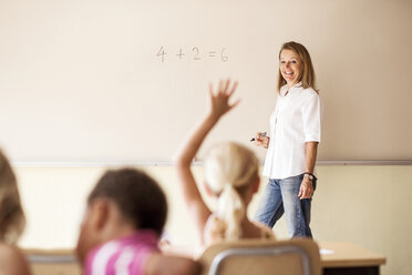 Mature teacher teaching mathematics to children in classroom - ASTF00071