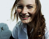 Portrait of a smiling young woman looking into a camera - INGF11736