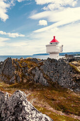 A lighthouse on the rocks by the sea - INGF11799